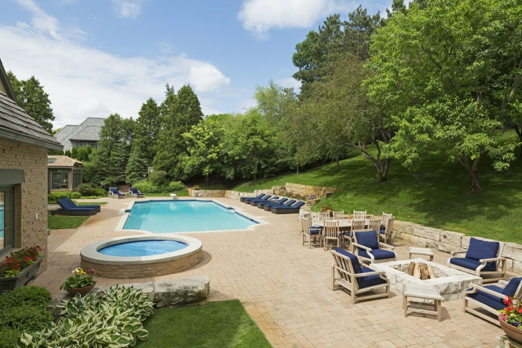 Home buyers want outdoor living spaces like patios, pools, fire pits, and more. Luxury edina homes.