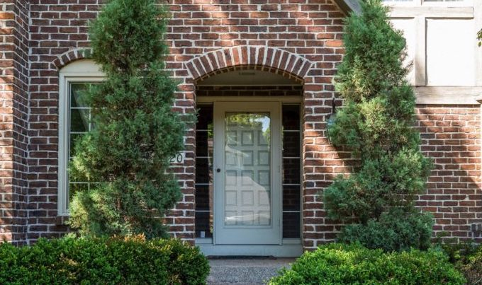 18520 Beaverwood Road features a large entry-way with both glass and wooden doors.